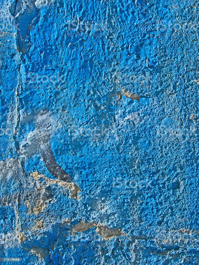 Old fissured wall painted with blue color stock photo
