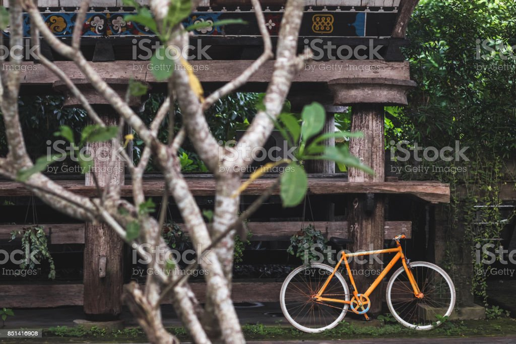 Old fixie bicycle as decoration of hotel in village rustic style in Bali tropical nature stock photo