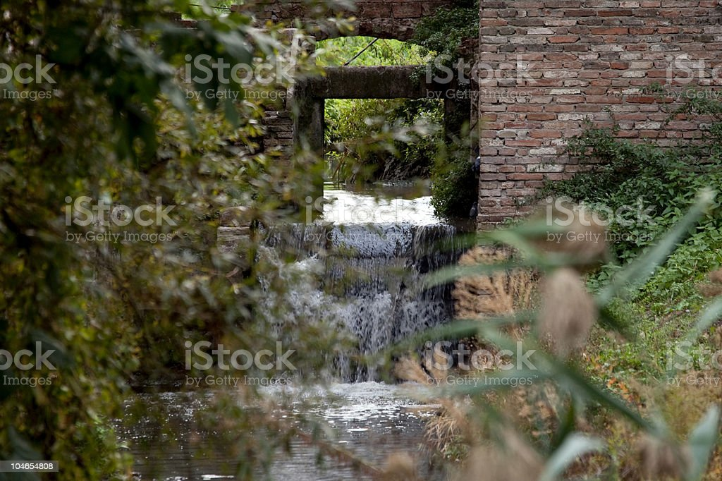 Old flour mill at water stock photo