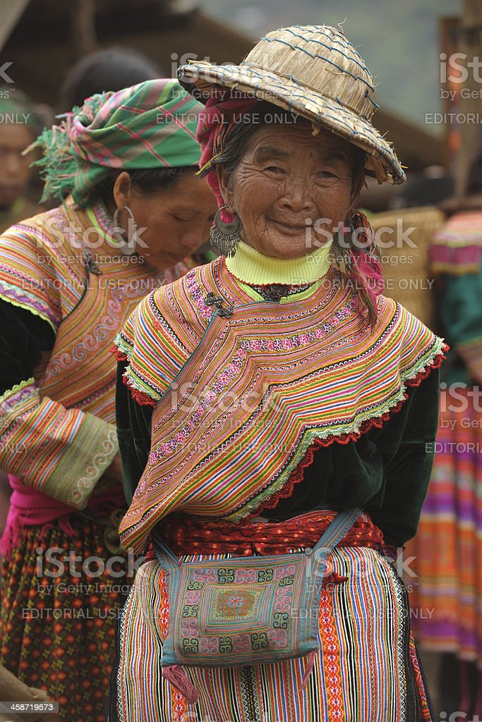 Old Flower HMong tribe lady with straw hat stock photo
