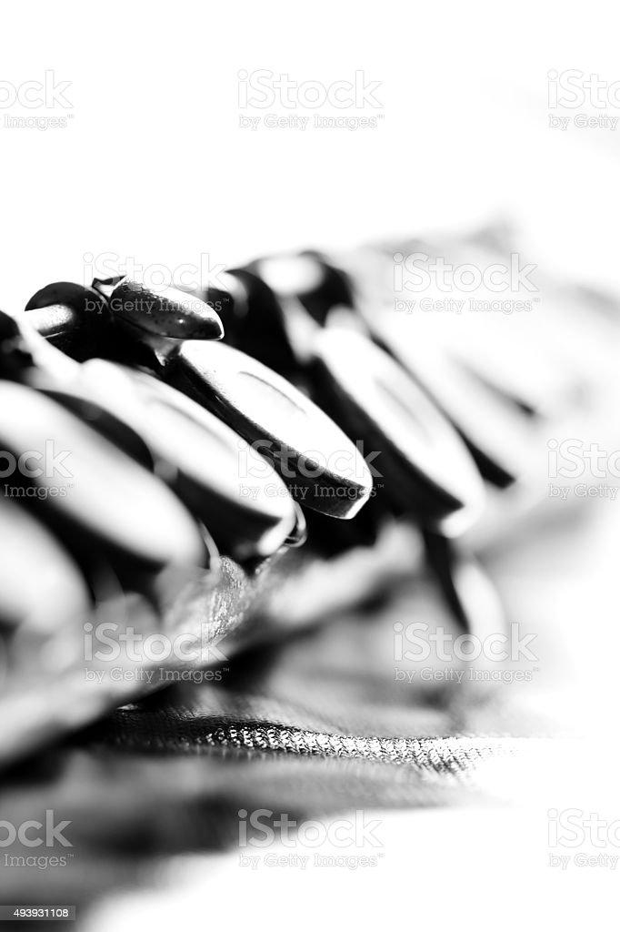 Old flute keys on white background stock photo