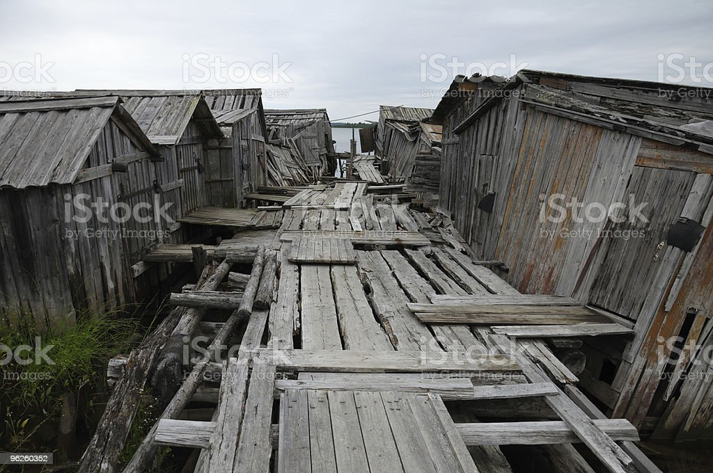 Old footway to abandoned slip docs stock photo