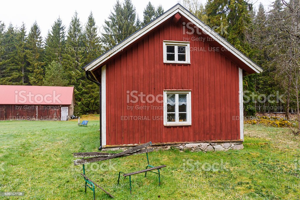 Old Forest Farmstead with garden stock photo
