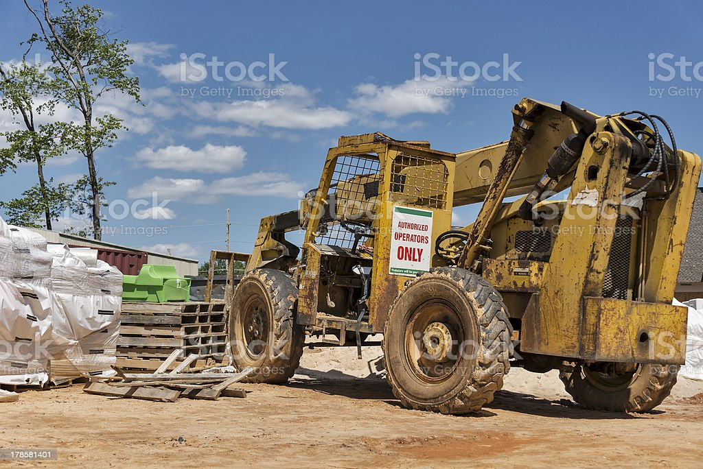 Old forklift on construction site royalty-free stock photo