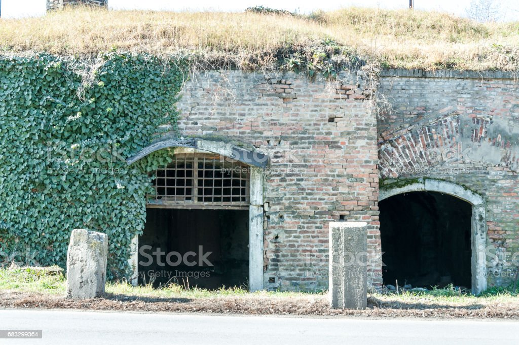 Old fortress dungeon entrance with metal gratings. stock photo