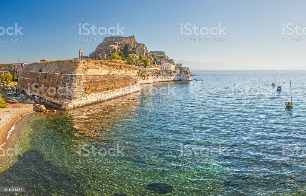 Old fortress walls and clock tower stock photo