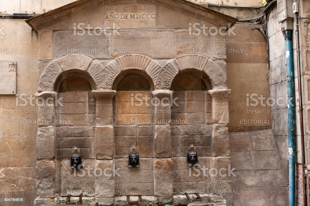 Old fountain in Bilbao stock photo