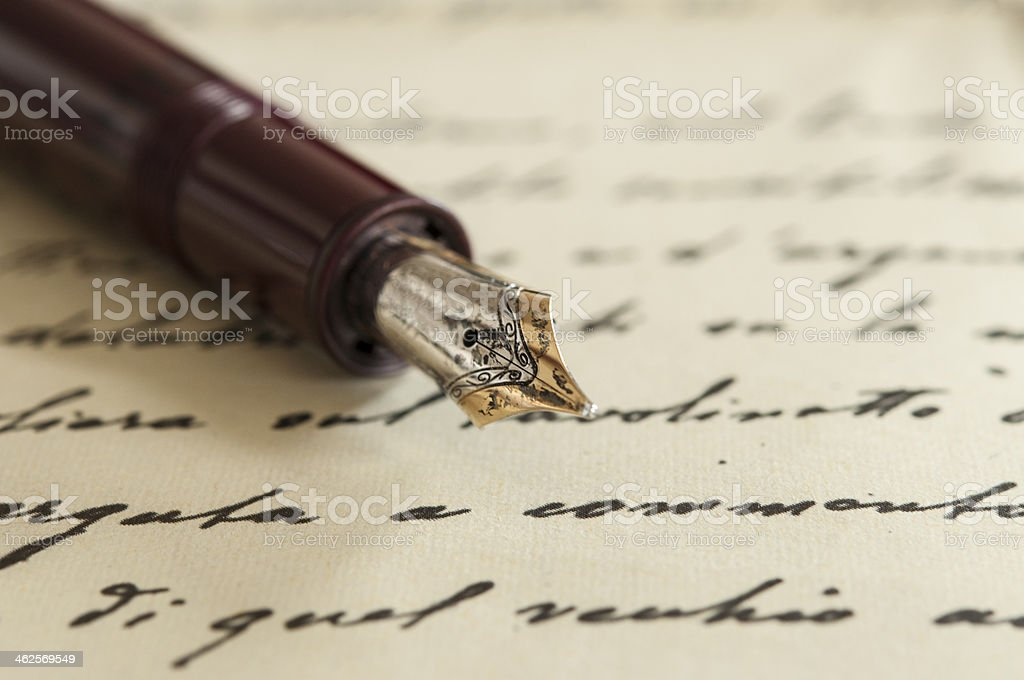 old fountain pen on manuscript stock photo