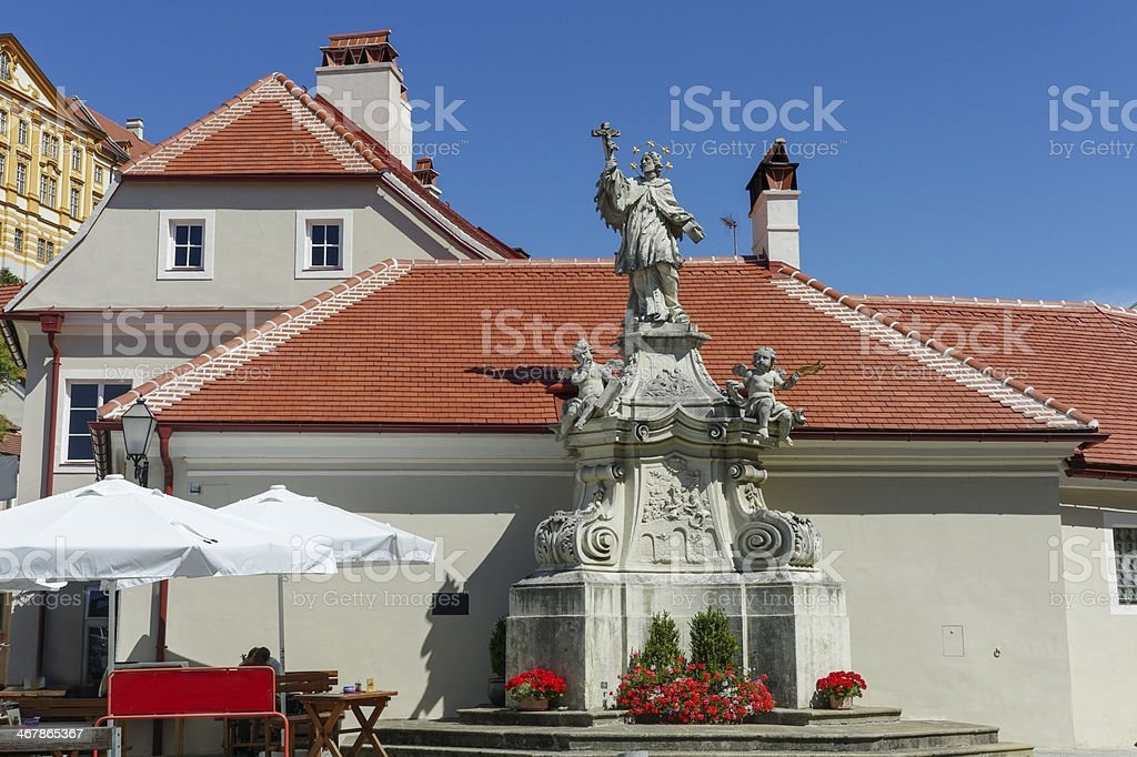 old fountain with statue at melk city center of austria stock photo
