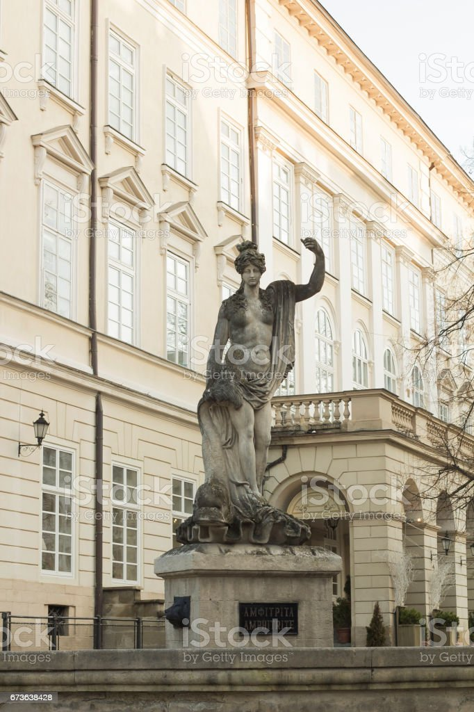 Old fountain with statue goddess of sea Amphitrite 18th century stands on market square of city Lvov, Ukraine stock photo