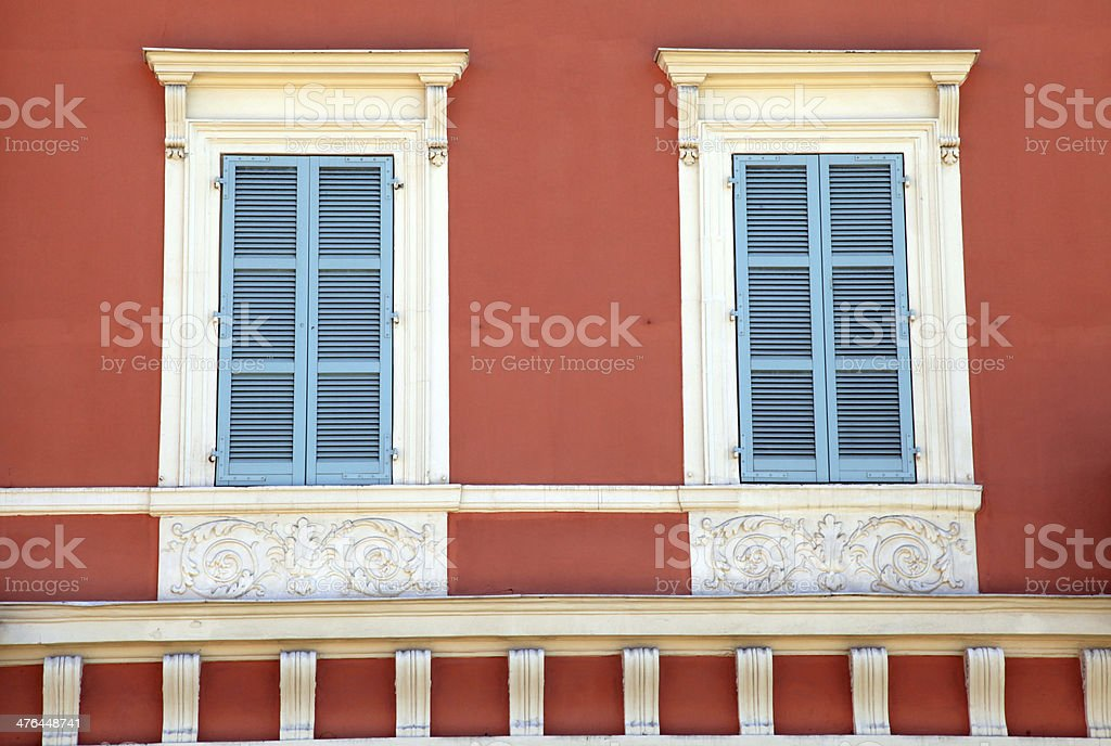 old french blue shutter windows in red house, Nice, France. royalty-free stock photo