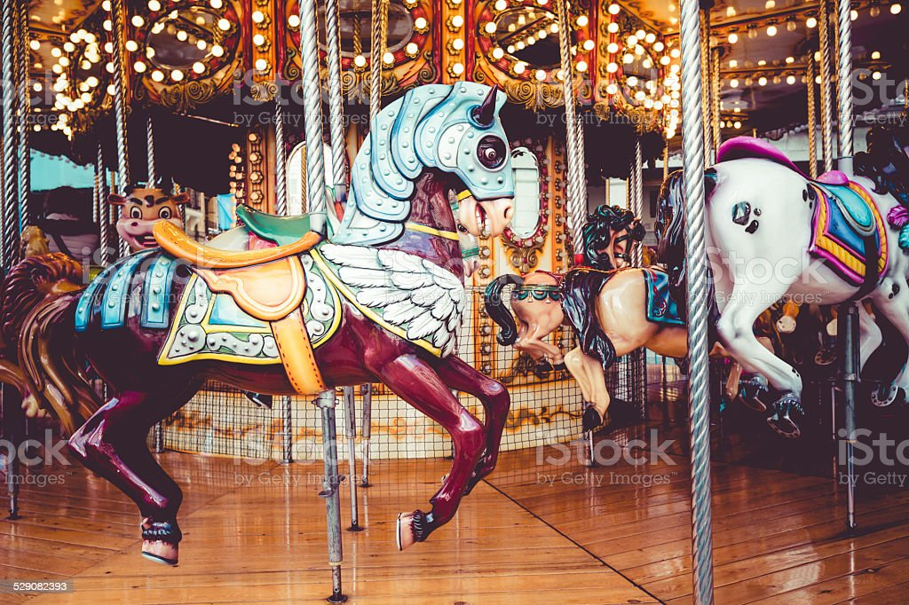 Old French carousel in a holiday park. stock photo
