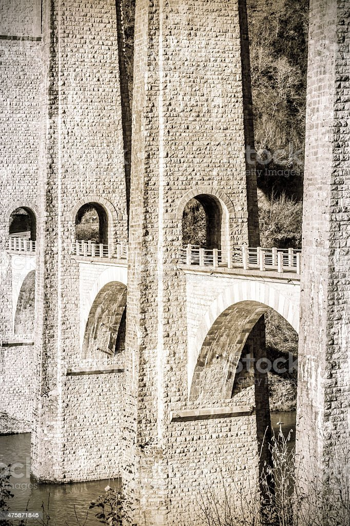 Old french stone bridge arch architecture in Rhone-Alpes stock photo