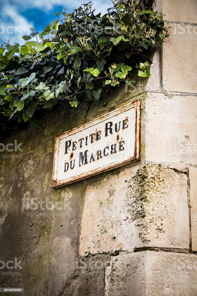 Old French street sign Petite Rue Du Marche stock photo
