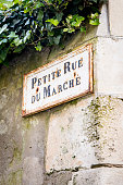 Old French street sign Petite Rue Du Marche