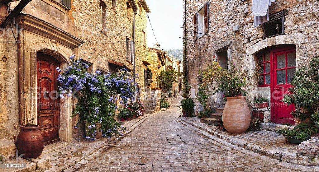 Old French village houses and cobblestone street stock photo