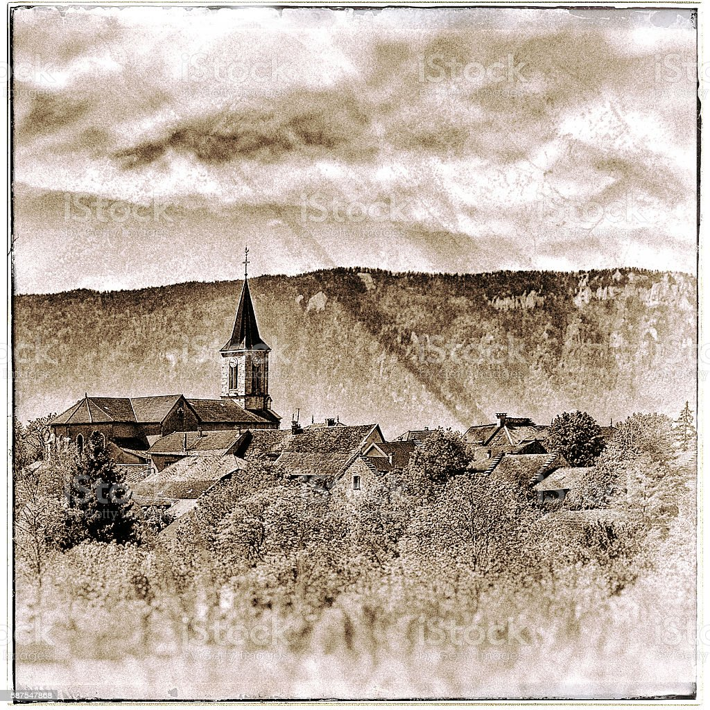 Old French village in countryside with mountains retro vintage styled stock photo