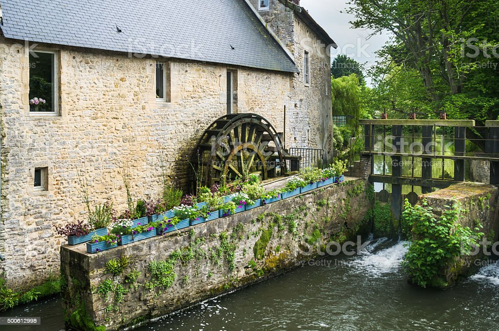 Old French Water Wheel stock photo