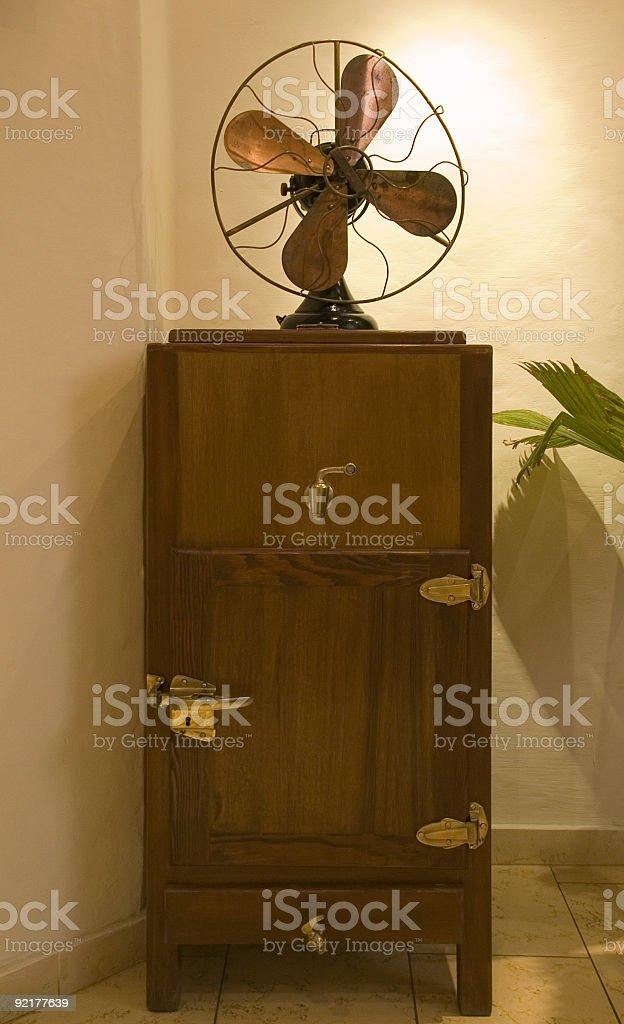 old fridge and fan stock photo