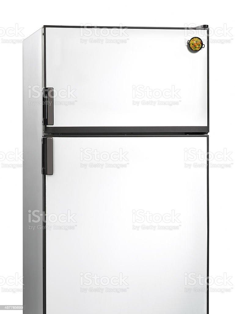 Old fridge with paella plastic magnet stock photo