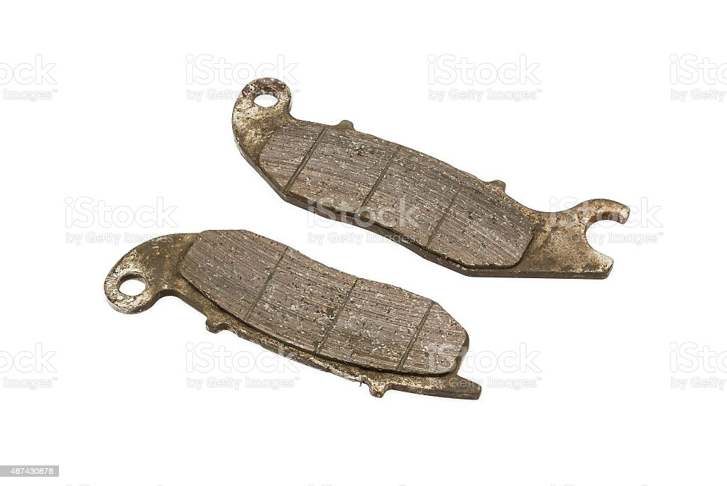 Old Front Disc Brake Pads of Sport bike stock photo