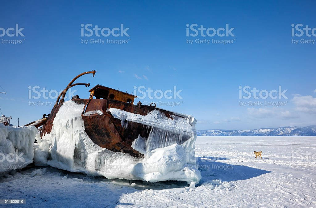 Old frozen ship on the bank of Olkhon island on lake stock photo