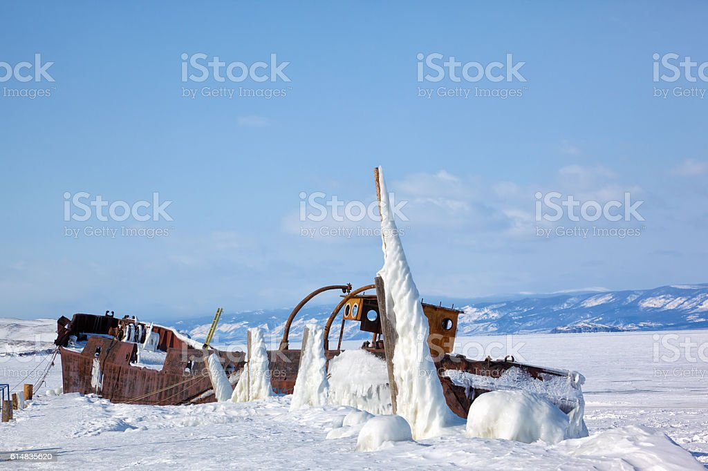 Old frozen ship on the bank of Olkhon island on siberian stock photo