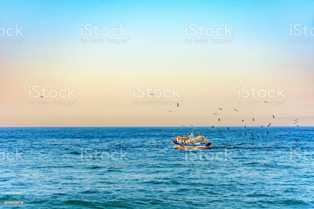 Old fshing trawler navigating stock photo