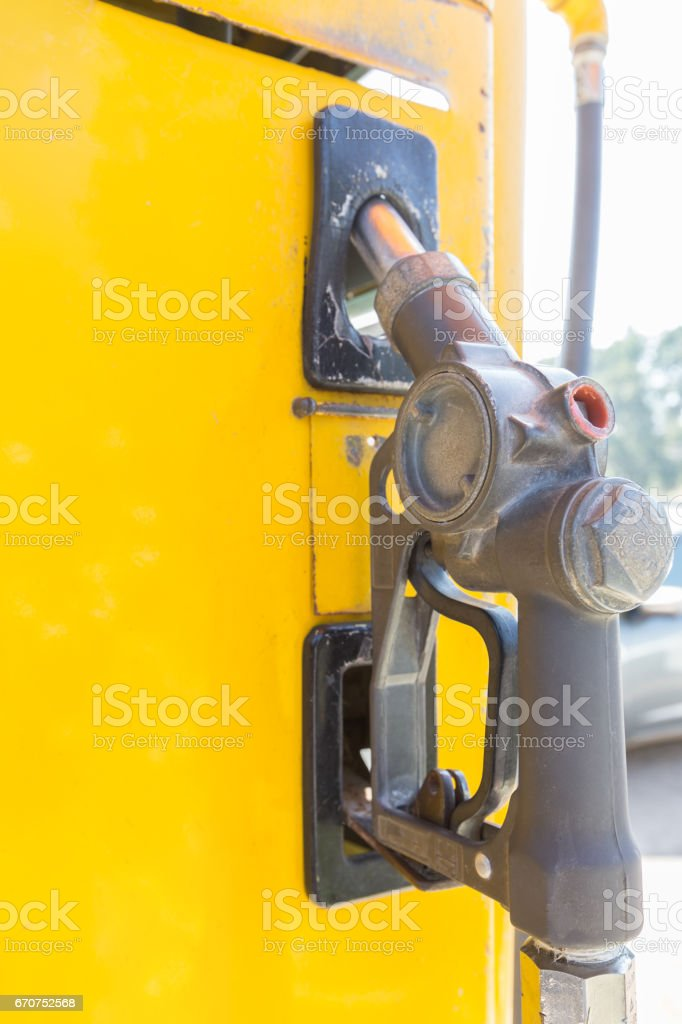 Old fuel nozzle or pumping gas. - Selective focus stock photo