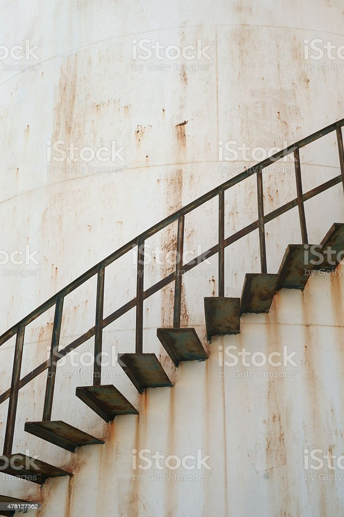 Old Fuel Storage Tank with Spiral Staircase stock photo