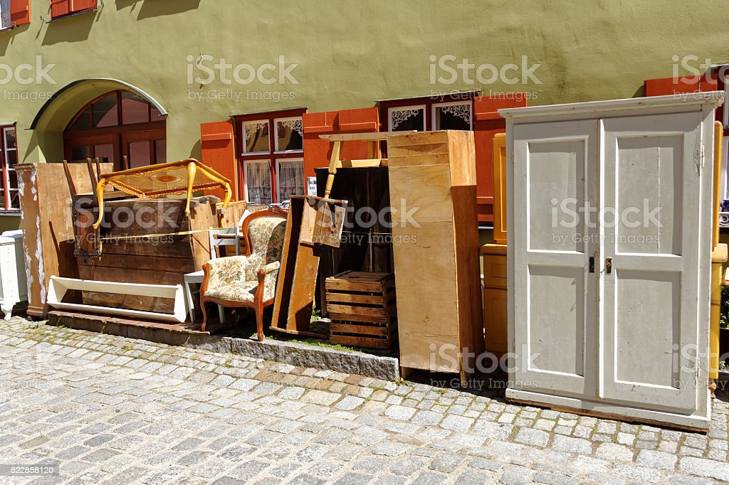 old furniture pieces on sidewalk stock photo