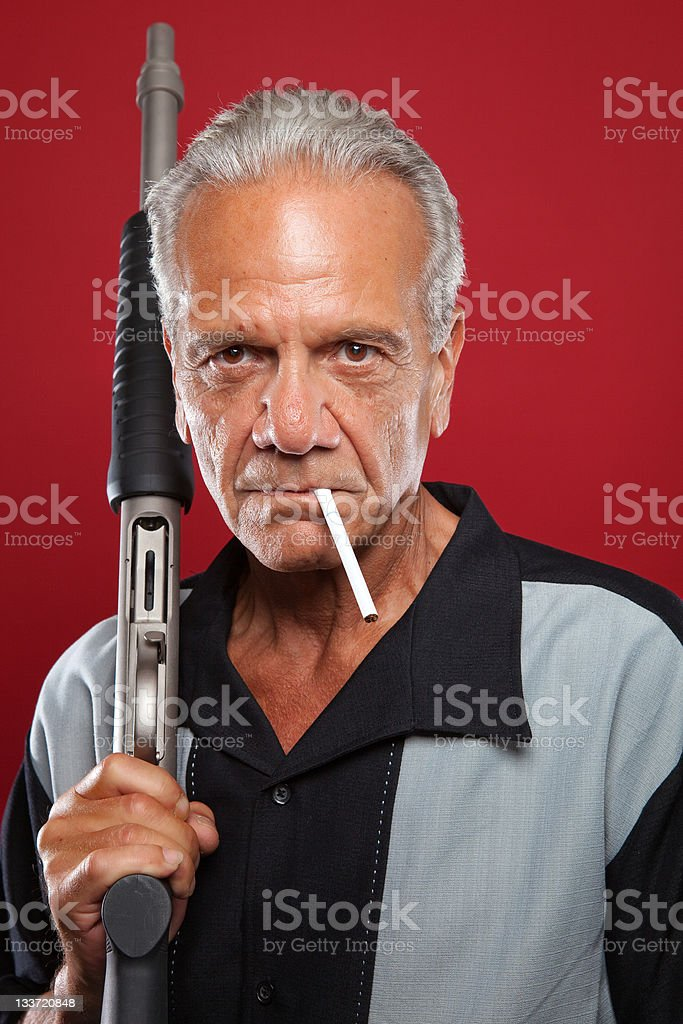 Old Gangster with a Shotgun royalty-free stock photo