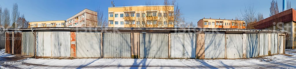 old garage doors in a row in the GDR stock photo