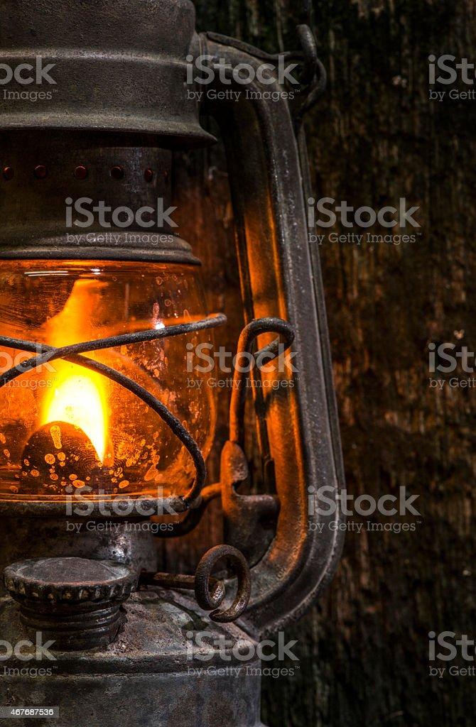Old gas lantern on wood stock photo