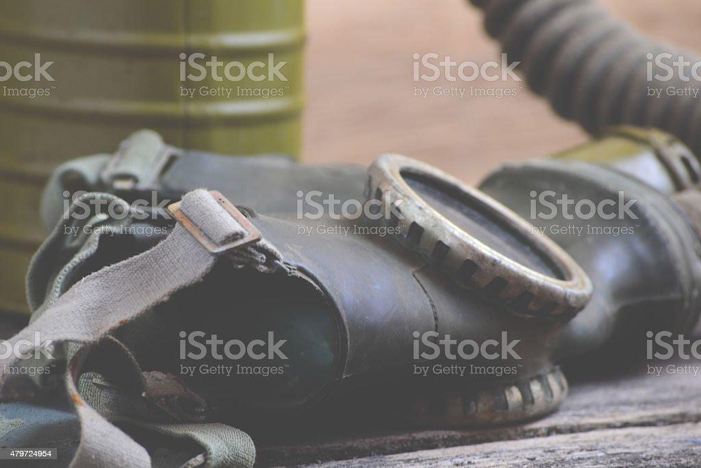 Old gas mask on wood background stock photo