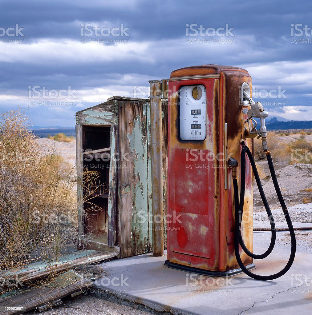 old gas pump at border of the desert stock photo