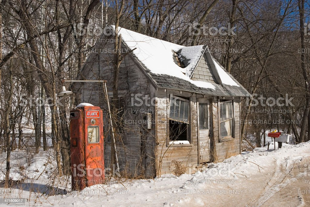 Old Gas Station Store and Pump in Rural Roadside America stock photo