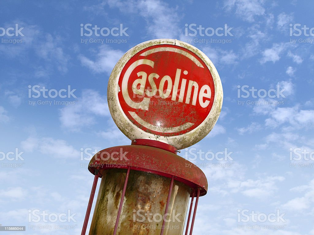Old Gasoline Sign Against Clouds royalty-free stock photo
