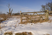 Old gate in a snowy field