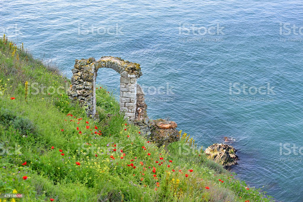 Old gate remains from ancient fortress stock photo