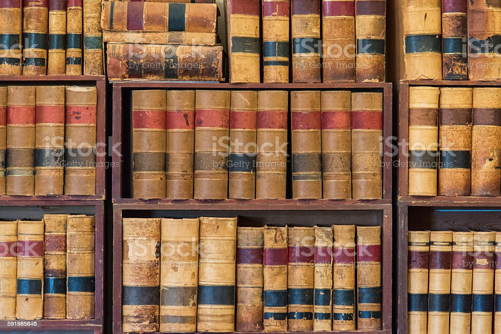 Full frame view of generic old books arranged on shelves in a library.