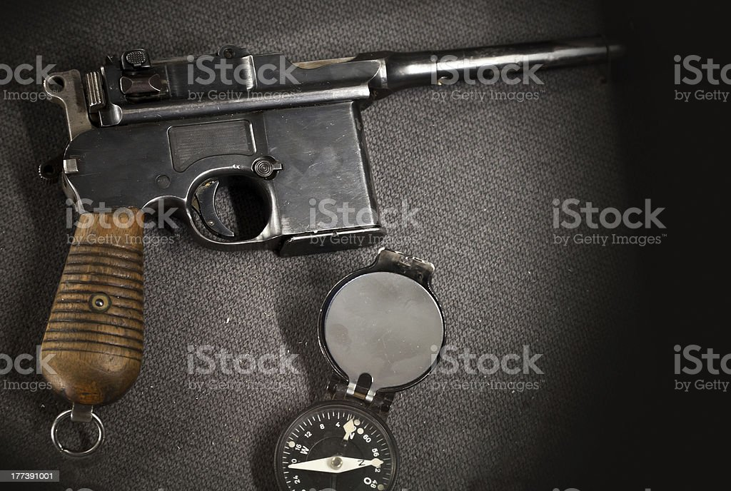 Old German pistol with compass royalty-free stock photo