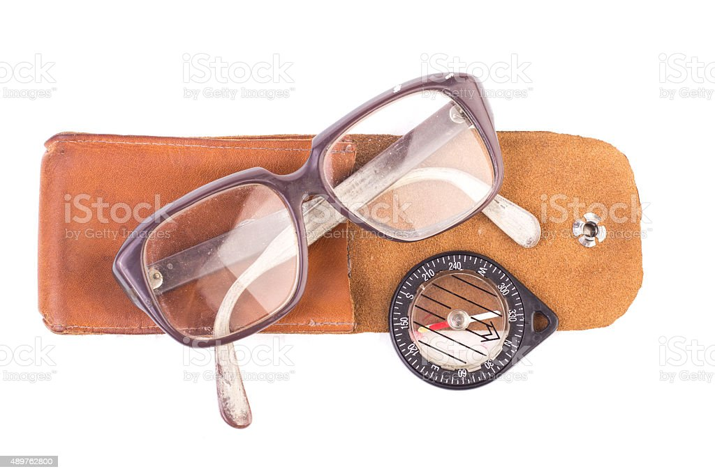old glasses and vintage compass in a leather case, isolated stock photo