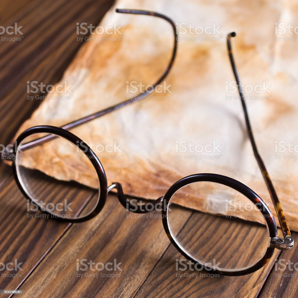Old glasses on the vintage document royalty-free stock photo