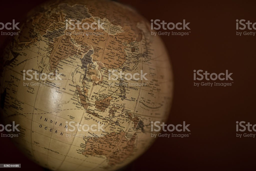 Old Globe in warm tones against a brown background stock photo