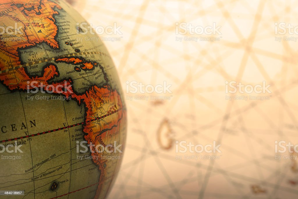 Old globe with map in the background stock photo