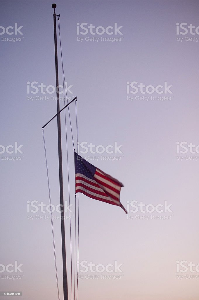 Old Glory at half mast stock photo