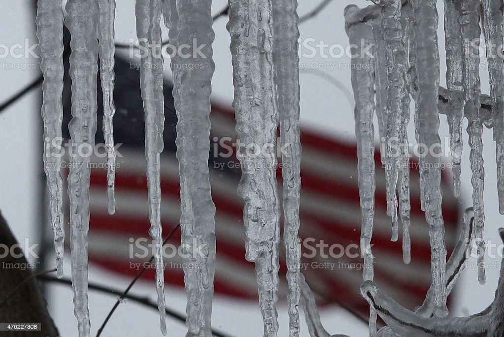 Old Glory through icicles stock photo