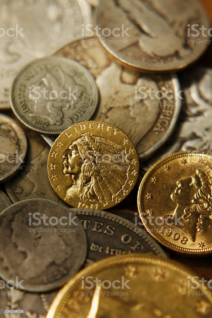 Old Gold and silver coins soft focus. stock photo