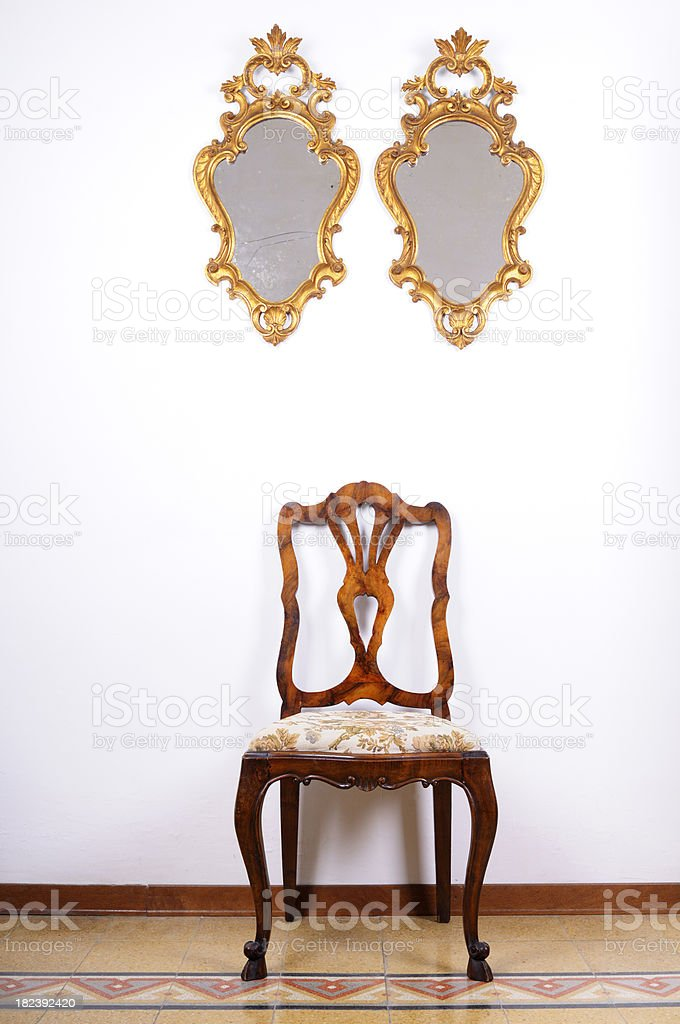 Old Gold Mirrors and Vintage Chair royalty-free stock photo